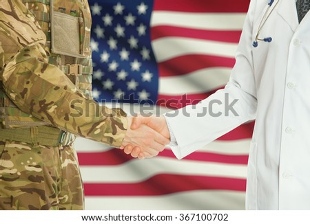 Soldier in uniform and doctor shaking hands with national flag on background - United States - stock photo