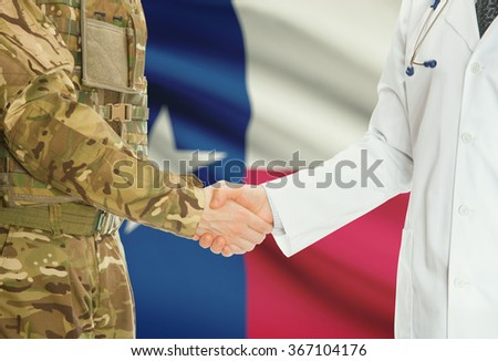Soldier in uniform and doctor shaking hands with US states flags on background - Texas - stock photo