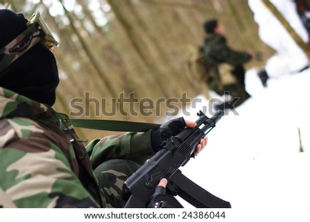 soldier in uniform with Kalashnikov