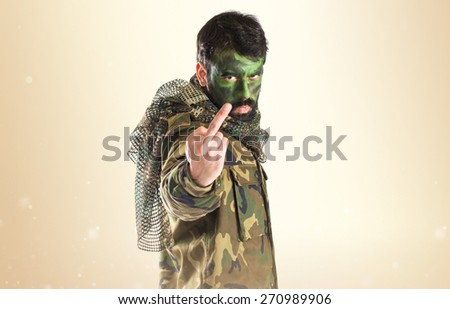 Soldier making horn gesture  - stock photo