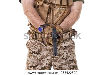 Soldier man holding his gun. - stock photo