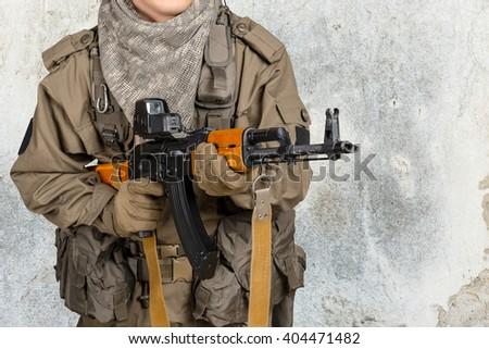 Soldier man holding his gun - stock photo