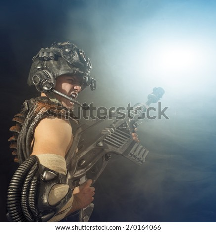 Soldier of the future goes on the attack - stock photo