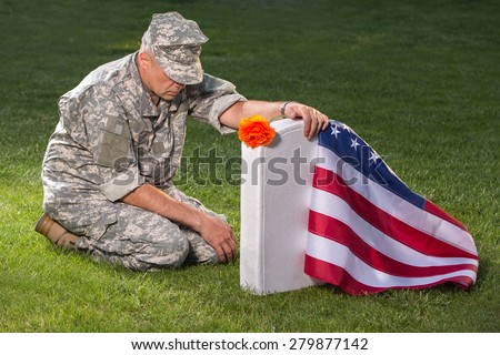 Soldier on american cemetery. Memorial Day concept - stock photo