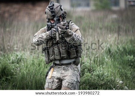 soldier on patrol - stock photo