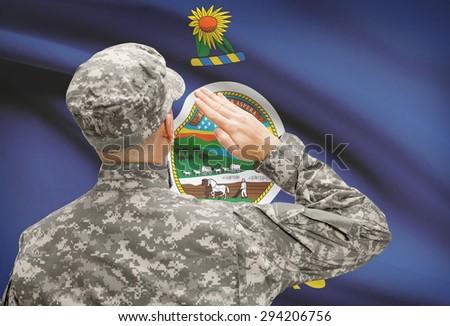 Soldier saluting to USA state flag conceptual series - Kansas - stock photo
