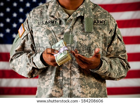 Soldier: Soldier Gesturing To Stack Of US Currency - stock photo
