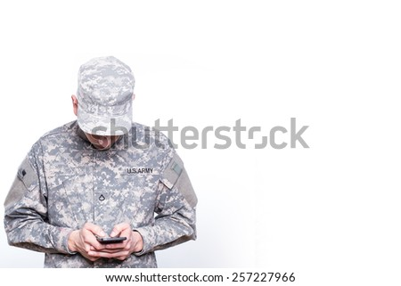 Soldier texting Home  - stock photo
