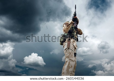 Soldier under sky - stock photo