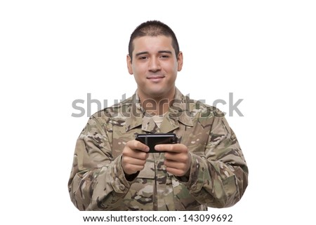 Soldier uses smartphone to text - stock photo
