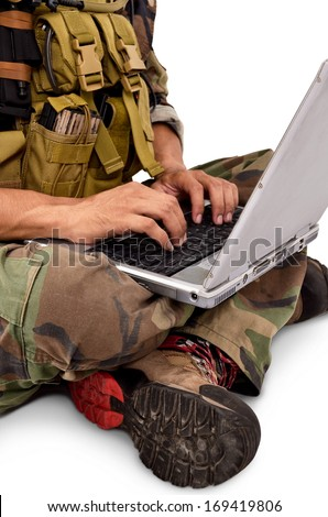 soldier was using a laptop, isolated on white background - stock photo