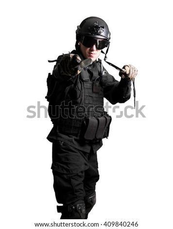 Soldier wearing black suit with double knife  isolated