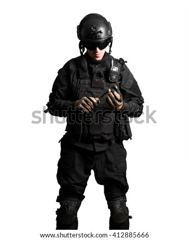 Soldier wearing black suit with knife isolated - stock photo