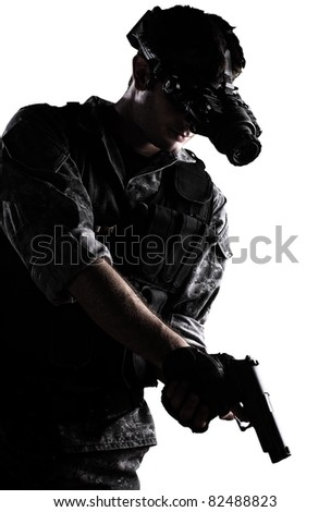 soldier wearing urban camouflage uniform with night vision goggles and a gun on white background - stock photo