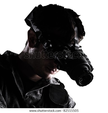 soldier wearing urban camouflage uniform with night vision goggles and a gun on white background