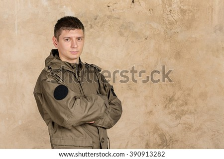 Soldier with arms crossed  - stock photo