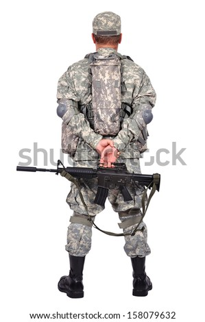 soldier with assault rifle standing back - stock photo