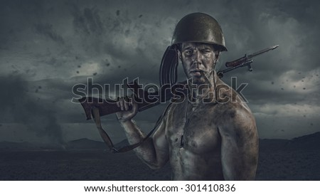 Soldier with cigar holding gun at battle fied - stock photo