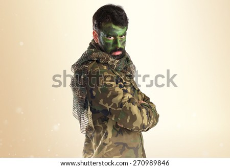 soldier with his face painted - stock photo