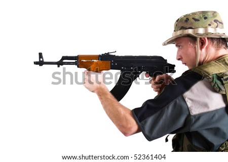 Soldier with kalashnikov assault rifle against white background.