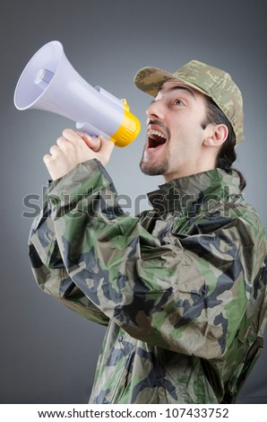 Soldier with loudspeaker shouting - stock photo