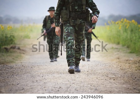 soldier with rifle gun  long range  patrolling on field