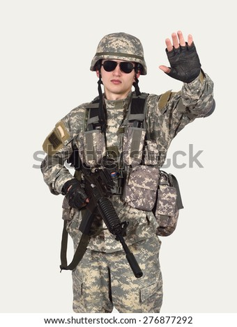 soldier with rifle showing stop symbol