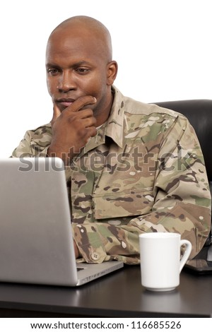 Soldier working on a laptop - stock photo