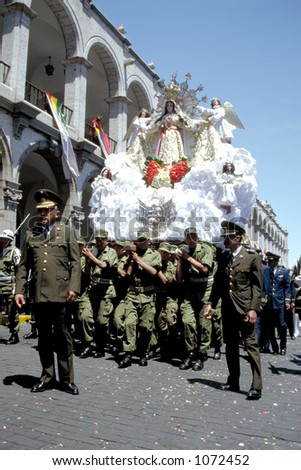 Soldiers carry a statue of Our Lady through the streets of Arequipa, a town in Southern Peru - stock photo
