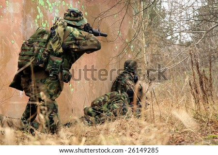 Soldiers game on military training ground ( battle camp ). Action. Operation. - stock photo