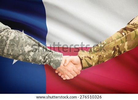 Soldiers handshake and US state flag - Texas - stock photo