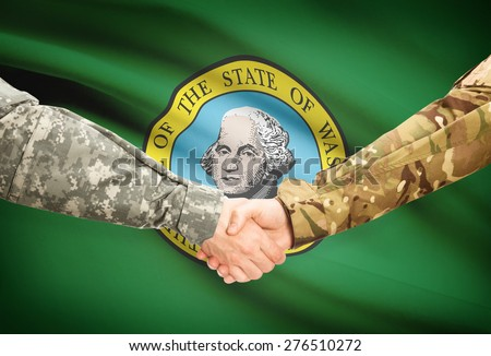 Soldiers handshake and US state flag - Washington - stock photo