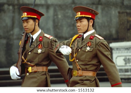 Soldiers march in front of the Ho Chi Minh Mausoleum Complex in Hanoi, Vietnam - stock photo