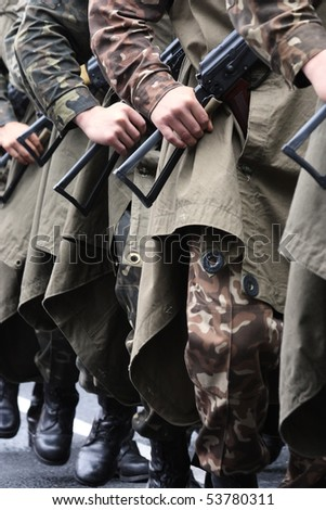 Soldiers marching on street during parade - stock photo