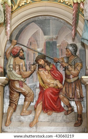 Soldiers plaited a crown of thorns, and put it on Jesus head - stock photo