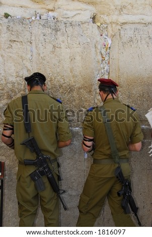 Soldiers Praying at the Western Wall Jerusalem - stock photo