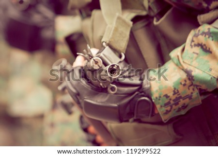 soldiers with assault rifle and camo suit - stock photo