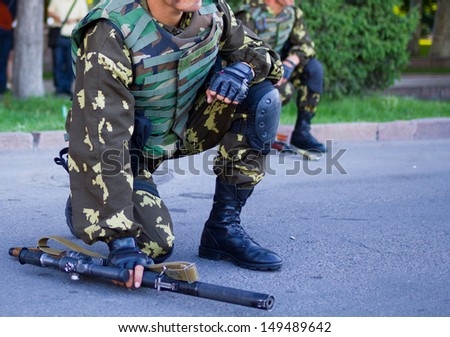 soldiers with guns Military parade Bishkek, Kyrgyz Republic - stock photo