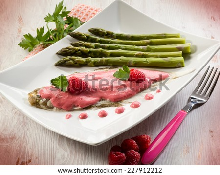 sole fish with raspberry cream and asparagus - stock photo