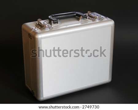 Solid, durable large silver case isolated on a dark background. - stock photo