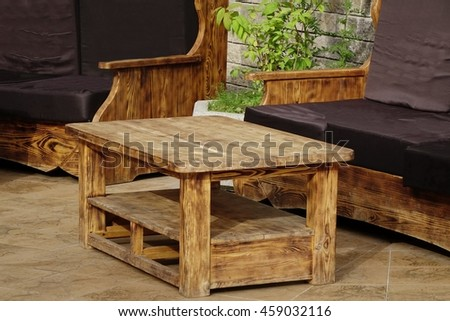 Solid Natural Wood Outdoor Handmade Table And Couch On The Terrace At Summertime