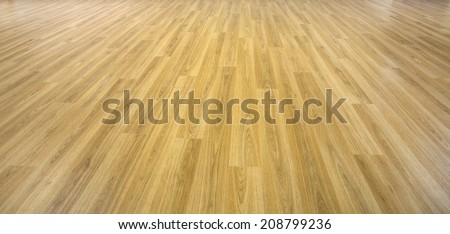 solid planks of oak timber on a empty wood floor - stock photo