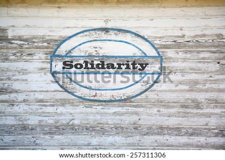 Solidarity Concept - Solidarity sign on shed side - stock photo