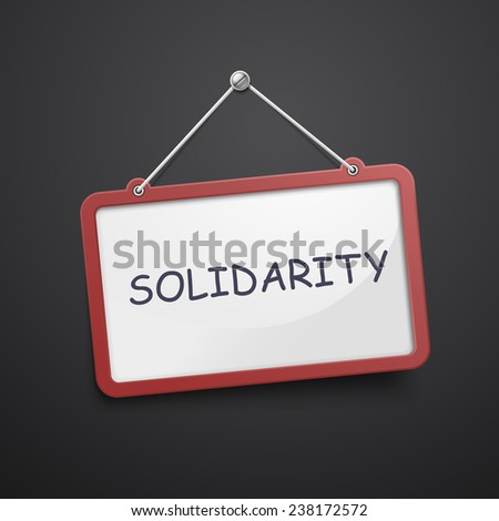 solidarity hanging sign isolated on black wall - stock photo