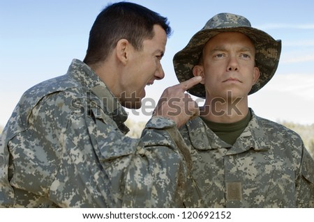 Solider shouting to teammate during a training session - stock photo