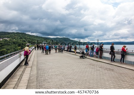 Solina, Poland -18 July 2016: The dam on the San River in Poland and the water reservoir Solina in cloudy weather - stock photo