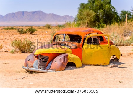 SOLITAIRE, NAMIBIA - JAN 5, 2016: Damaged abandoned car at the  service station at Solitaire in the Namib Desert, Namibia. Popular oturistic destination - stock photo