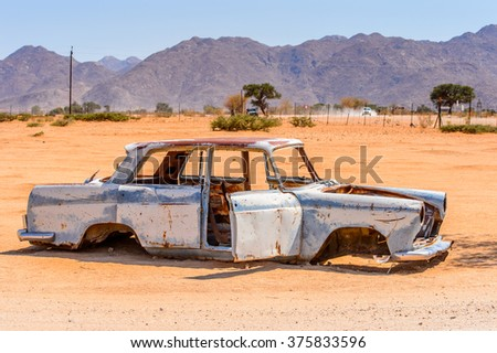 SOLITAIRE, NAMIBIA - JAN 5, 2016: Damaged abandoned car at the  service station at Solitaire in the Namib Desert, Namibia. Popular oturistic destination