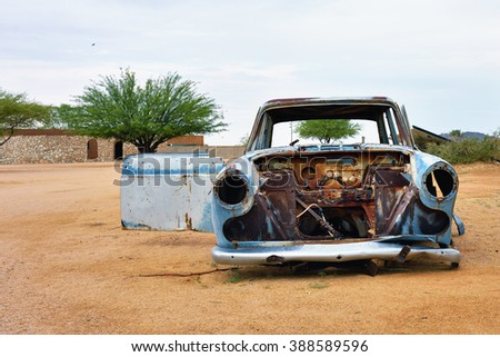 SOLITAIRE, NAMIBIA - JAN 30, 2016: Damaged abandoned old car at the service station at Solitaire in the Namib Desert, Namibia. Popular touristic destination