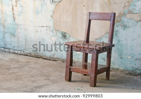 Solitary Chair on dirty background.